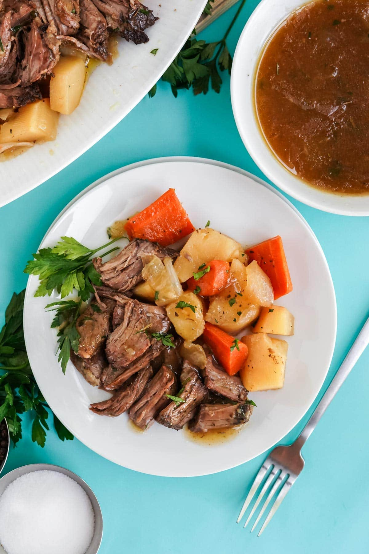 overhead view of pot roast and vegetables on a plate