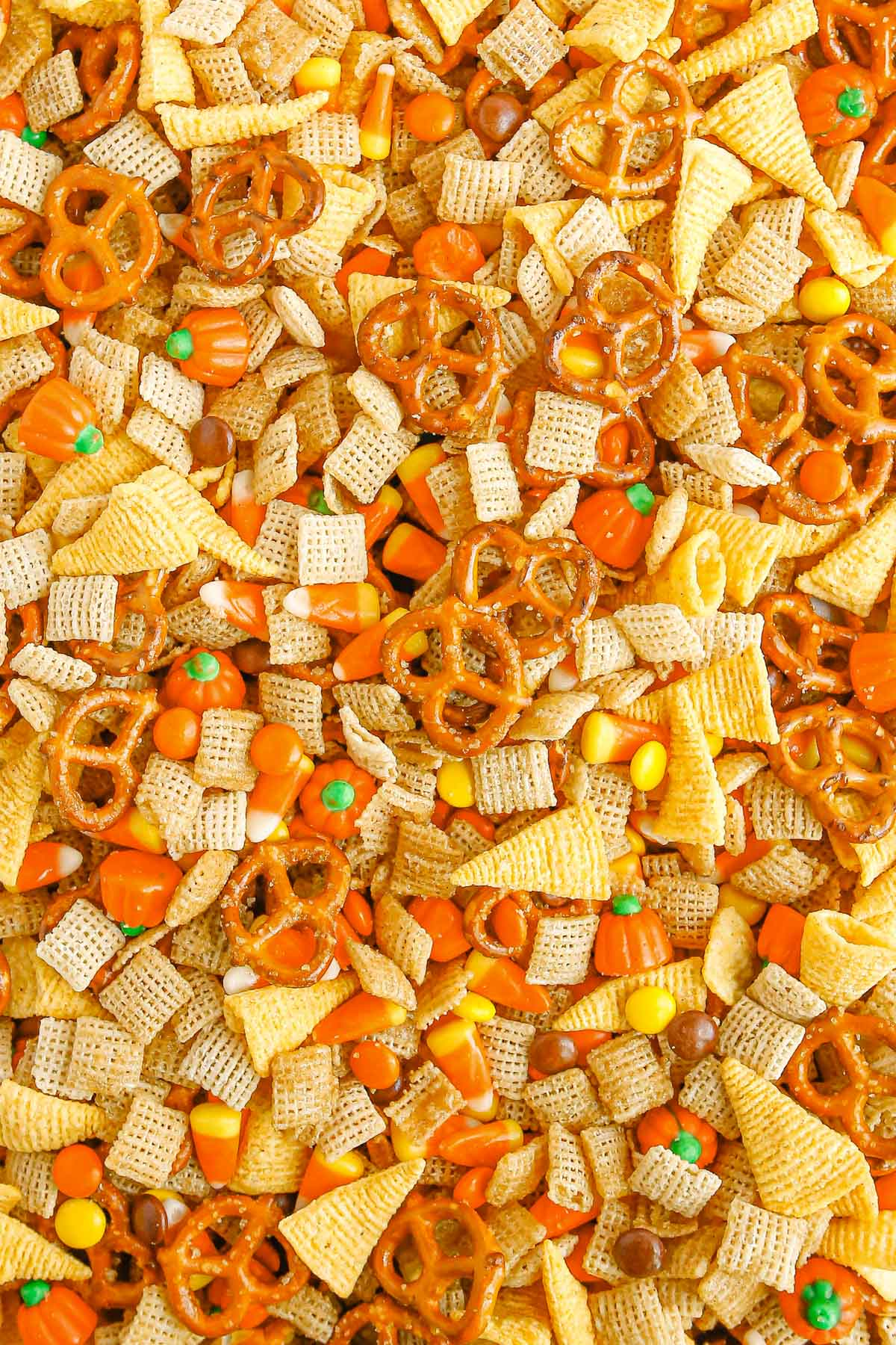 chex mix with cereal, chips, candy corn and pretzels