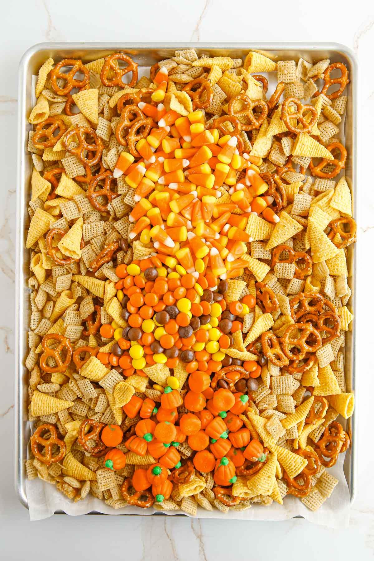 chex mix with candy layered on top